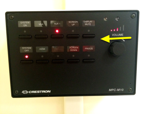 To decrease the volume of your audio, turn the knob on the Projector Control Panel to the left.