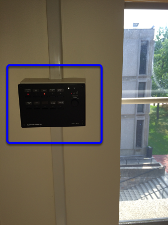 To adjust the volume for the video, locate the Projector Control Panel on the wall.