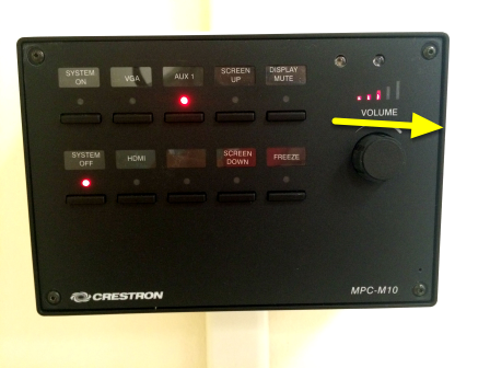 To increase the volume of your audio, turn the knob on the Projector Control Panel to the right.