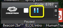 To freeze the image being projected, click the pause button (the icon with two vertical lines).