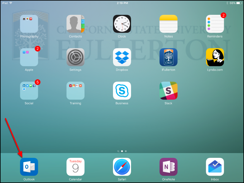 iPad home screen with an arrow pointing to the Outlook app