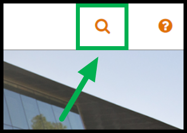 Closeup of green arrow pointing to Search icon.