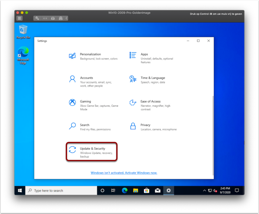 Select Update & Security in the Windows 10 image.