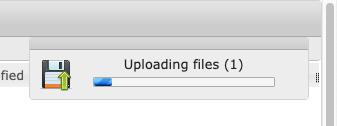 File uploadd progress displays in top right corner